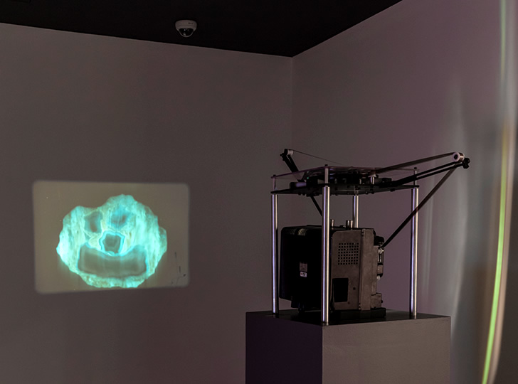 """'Installation view of Rocks, Stones, and Dust, 2015. Lindsay Lawson, Smiling Rock Screen Test, 2015. 16mm film loop. Image credit: Toni Hafkenscheid"""""""