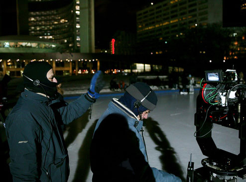 """Production image from Mark Lewis, Nathan Phillips Square, A Winters Night, Skating, 2009"""