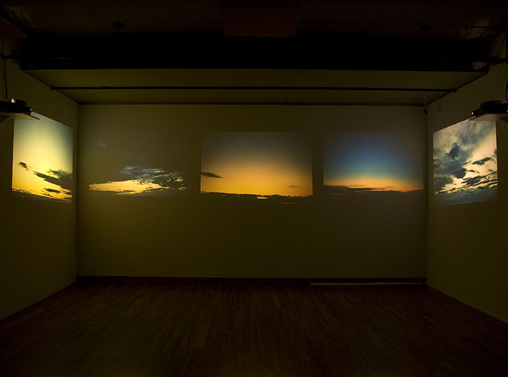 """""""Installation view of Projections, 2007. Image credit: Toni Hafkenscheid. Gar Smith, Notes on Light, 1969-70. 1200 35 mm colour slides and 3 sound tapes, 5.1 x 5.1 cm each. National Gallery of Canada, Ottawa"""""""