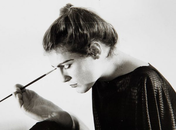 Lorenza Böttner painting her face using her foot.