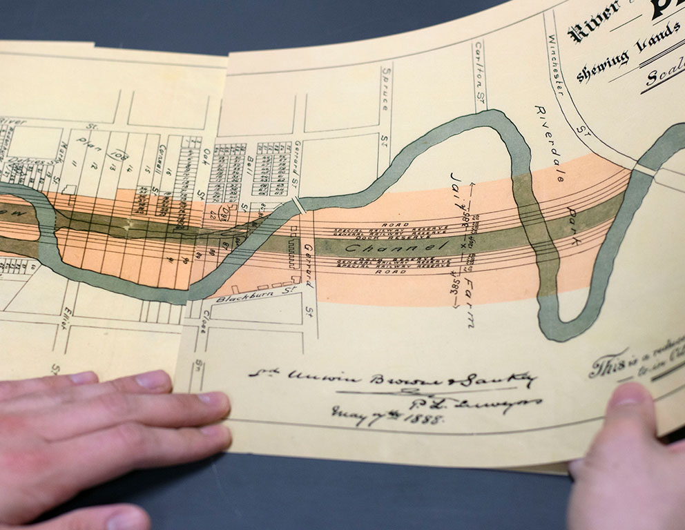 Artist holding image of River Don Straightening Plan, 1886.