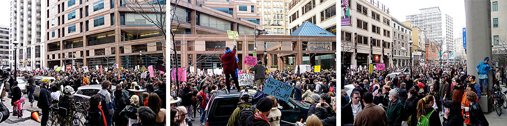 A group of people in protest in front of the Toronto Police Headquarters.