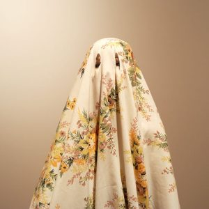 Woman wearing bedsheet with eye cut outs
