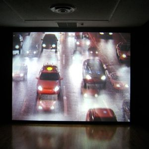 """Installation view of Stutter and Twitch, 2008. Yael Bartana, Trembling Time, 2001. Video projection. 6:20 min. Image credit: Toni Hafkenscheid"""