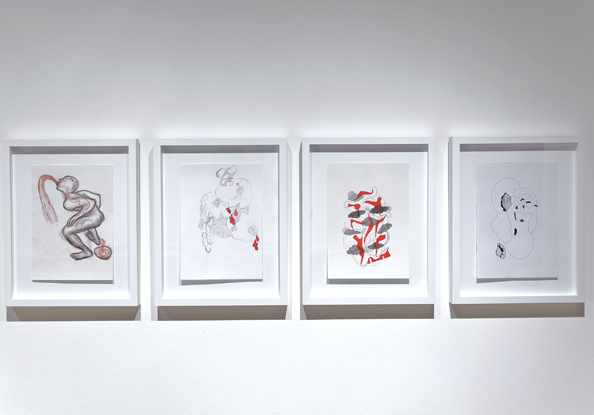 Four drawings framed on wall