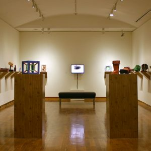 Several small sculptures on display in gallery