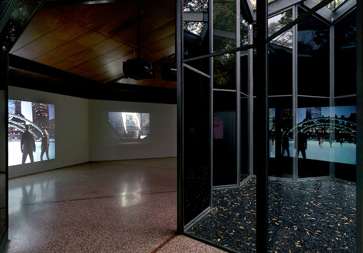 Glass atrium in gallery with projections