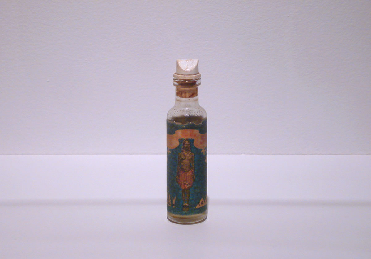 Glass vial with picture of woman
