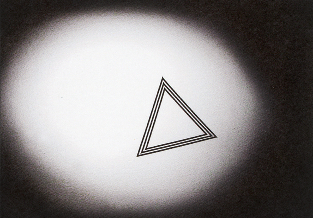 Black background with spotlight on triangle