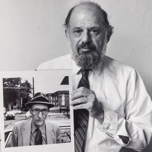 """Robert Giard, Allen Ginsberg with his own portrait of Burroughs, 1986. Gelatin silver print. 41 x 51 cm. University College Collection. Gift of Jonathan Silin, 2012"""
