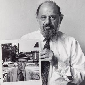 Allen Ginsberg holding portrait of Robert Giard