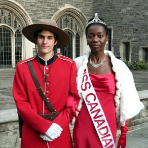 Man dressed as Mountie next to Miss Canadiana