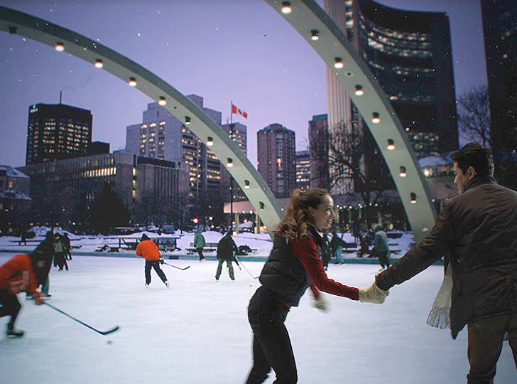 """Mark Lewis, Nathan Phillips Square, A Winter's Night, Skating (video still), 2009. Single screen projection, 35mm. 4 minutes"""