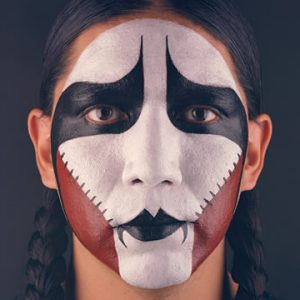 Woman in braids with face paint