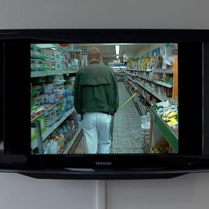 Video still of man in grocery store
