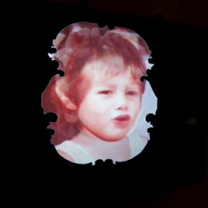 Ornate cutout of photo of young girl
