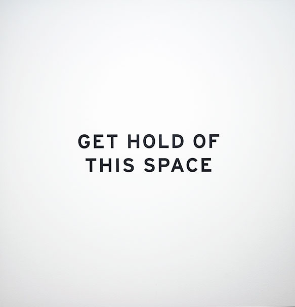 """black text saying """"GET HOLD OF THIS SPACE"""" against a white background"""