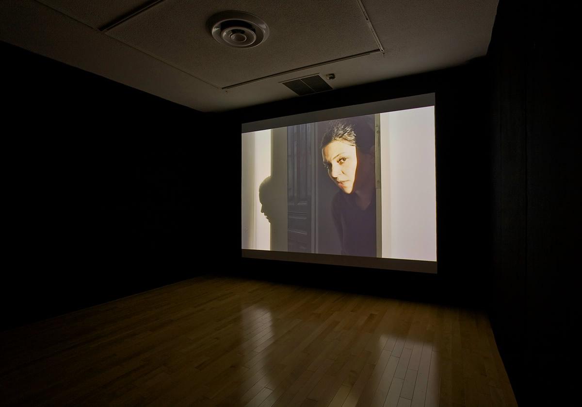 Video still of woman in doorway
