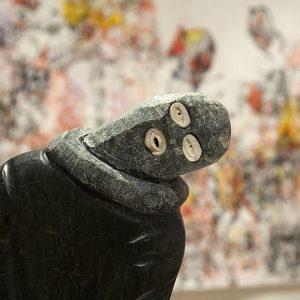 Stone sculpture of person in ski mask
