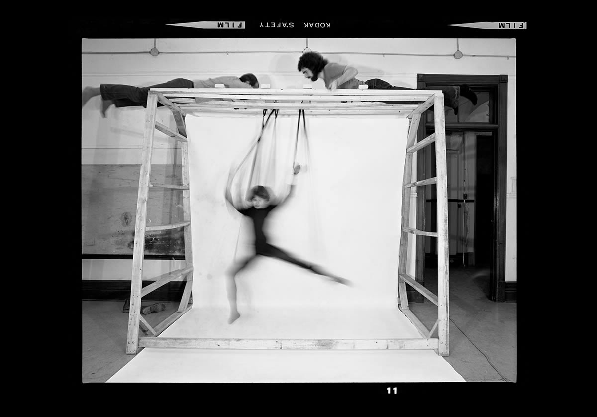 Woman in motion swinging on apparatus