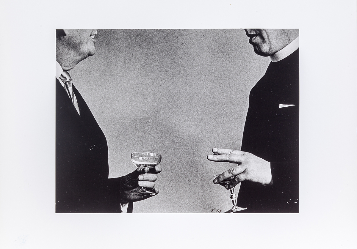 Two men holding coupe glasses