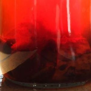 Jar with red substance