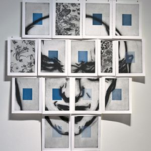 A man's face over blue squares split into 15 sheets of paper