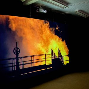 """Installation view of Mark Boulos: All That is Solid Melts Into Air, 2011. Image credit: Toni Hafkenscheid"""