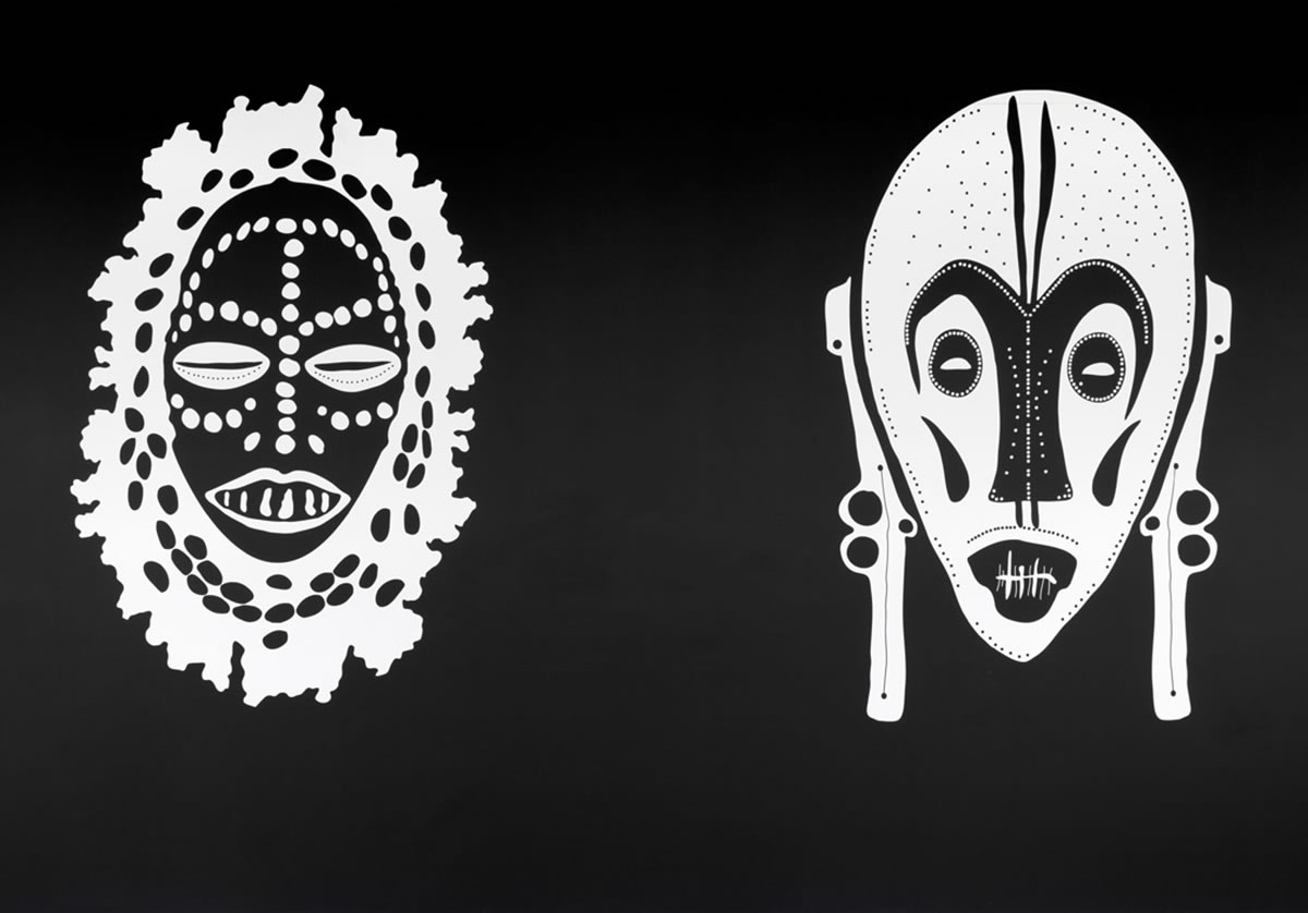 Two prints of masks against white background
