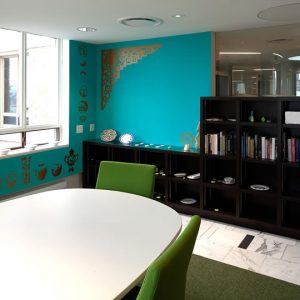 Meeting room with turquoise and gold walls