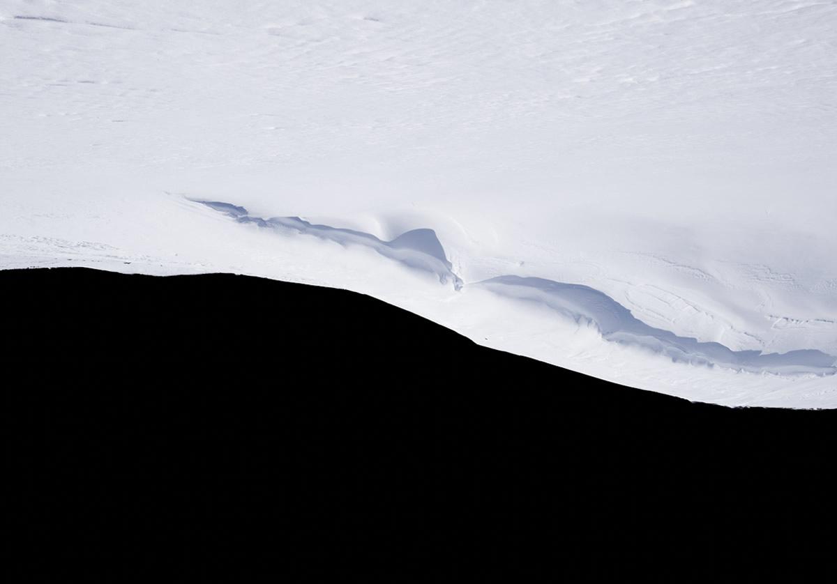 White snowy tundra against black background