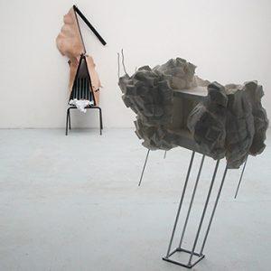 Plaster and metal sculptures in gallery