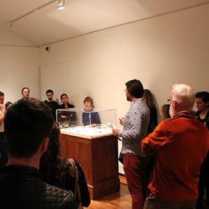 John G. Hampton giving a curator's tour