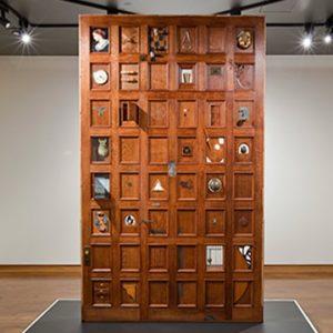 Wooden door with tiles
