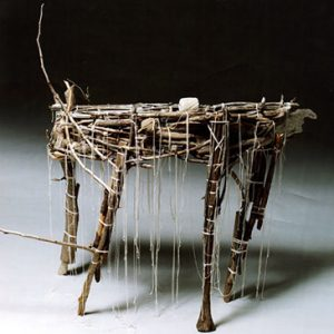 """Gord Peteran, An Early Table, 2004. Twigs, string. 91cm X 101cm X 43cm. Courtesy of William Anderson. Photo by Elaine Brodie"""