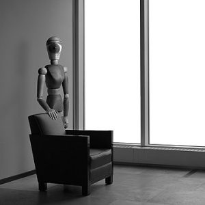 Model figure with hand on chair
