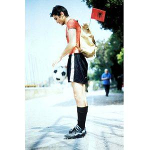 Man dribbling a soccer ball