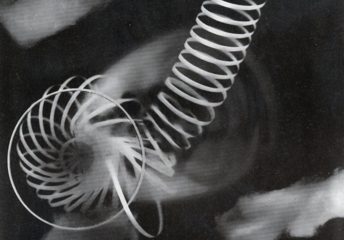 A black and white lightbox of a spiral shape