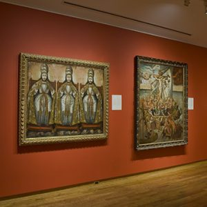 Two biblical paintings installed in gallery