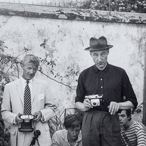 Vintage photo of two men holding cameras