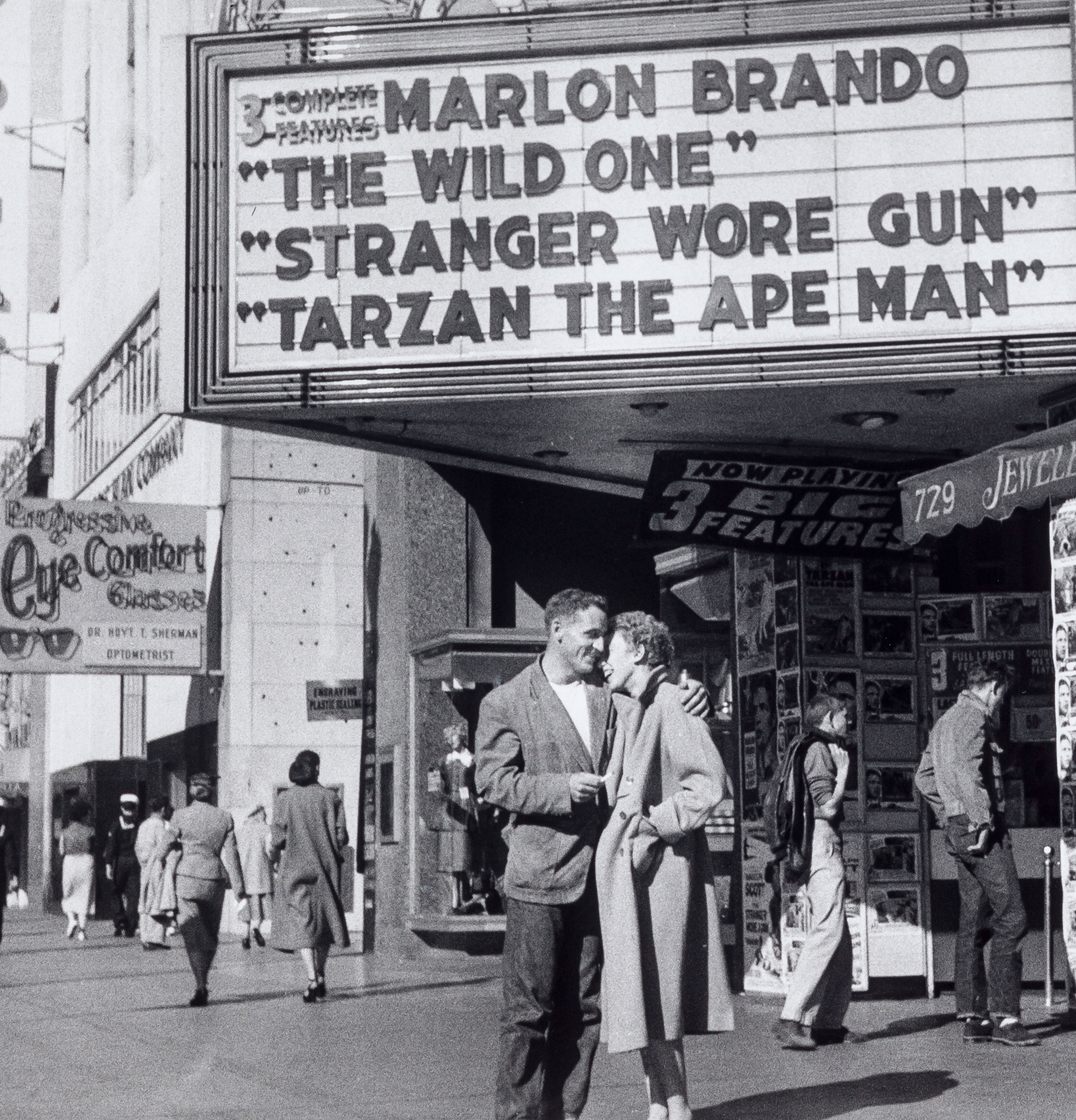 A couple under a theatre marquee