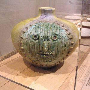 Yellow jug with green face