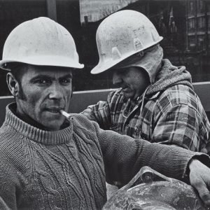 Two construction workers in black and white