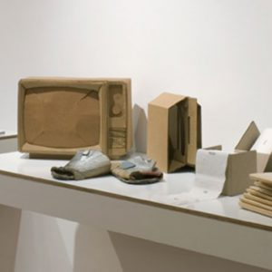 Various objects made from cardboard on display