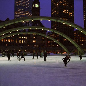 """Mark Lewis, Nathan Phillips Square, A Winter's Night, Skating (video still). 2009. Single screen projection, 35mm. 4 minutes"""