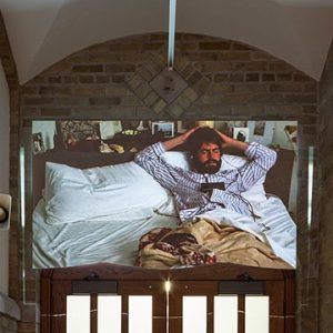 Large photo of man in bed over doorway