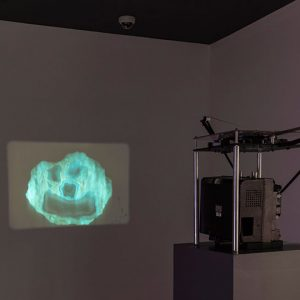 """Installation view of Rocks, Stones and Dust, 2015. Lindsay Lawson, The Real Smiling Rock Last Updated 11-06-2015, HD video continually updated as versions, 2015. Image credit: Toni Hafkenscheid"""