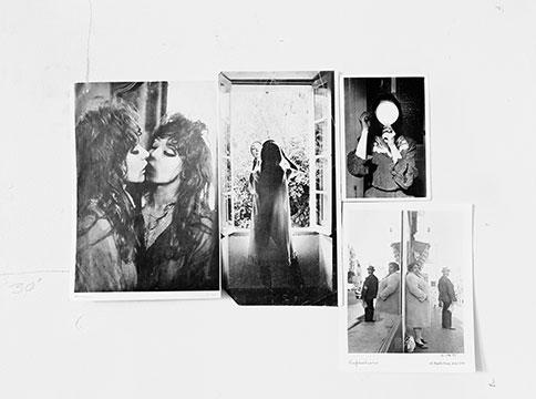 Four inkjet print photos of women on wall