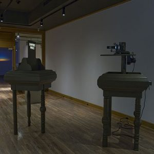 """Installation view of Projections, 2007. Image credit: Toni Hafkenscheid. Ian Carr-Harris, Empire Piece, 1970-71. Two painted wooden units, one with slide projector and 35mm slide. 187.3 x 245 x 80.7 cm assembled. National Gallery of Canada, Ottawa"""