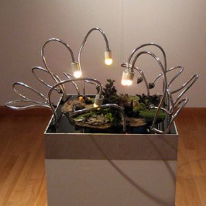 """""""Installation view of Stutter and Twitch, 2008. Jennifer and Kevin McCoy, Scary Things #2 (detail), 2006. Mixed media sculpture with 10 cameras and live video output. 61 x 61 x 76 cm"""""""